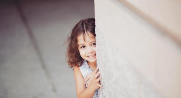Girl behind wall